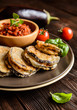 Roasted eggplant slices covered in egg, stuffed with Mozzarella, served with tomato salsa