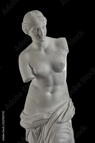 a statue of Venus, plaster column on a black background