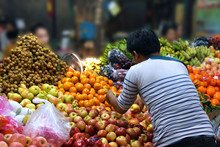Woman Selling Vegetables In The Market