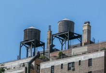 Old Wooden Water Tanks On Roofs On New York City's Residential Buildings.