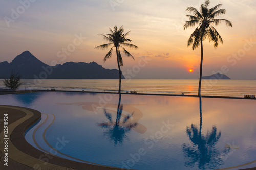 Fotografie, Obraz  The reflection of the beautiful sky in the pool at sunset and th