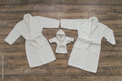 Fotografie, Obraz  Three white Bathrobe
