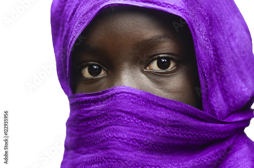 Gorgeous African Girl Hidden by a Violet Head Scarf Outdoors (Isolated on White)