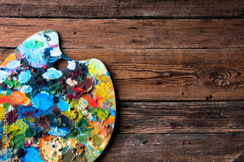 Painting palettes on wooden background