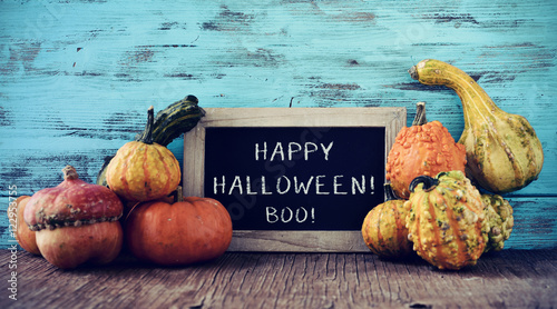 pumpkins and chalkboard with text happy halloween Canvas-taulu