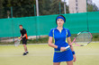 Portrait of female and male tennis players playing doubles outdo