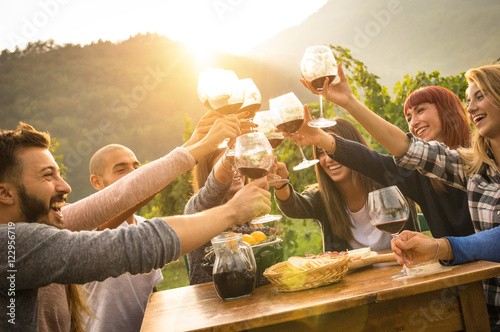 Happy friends having fun outdoors - Young people enjoying harvest time together Poster