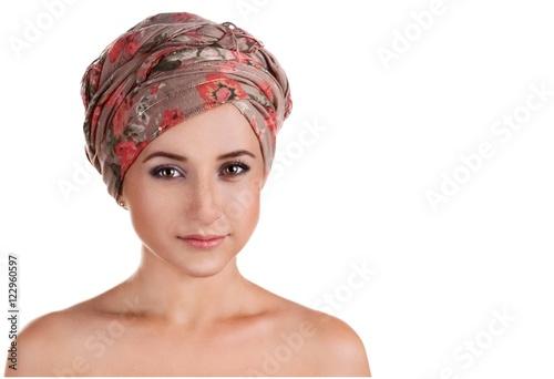 portrait of white-skinned girl in a turban. caucasian woman with Fototapeta