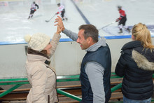 Ice Hockey Supporters Doing High Five