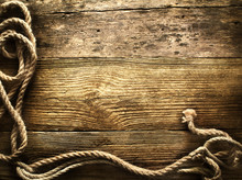 Old Rope On Vintage Wooden Background
