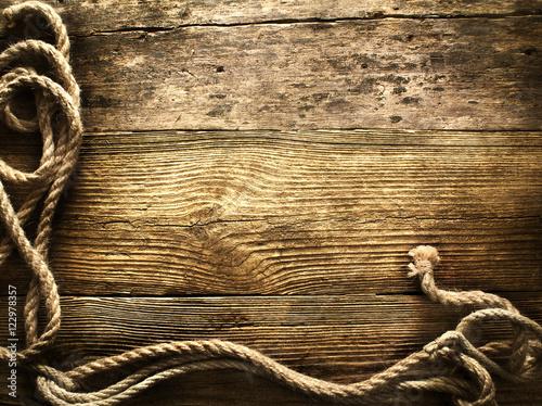 Fotografía  old rope on vintage wooden background