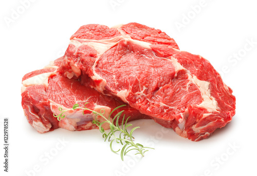 Poster Vlees Raw steak isolated on white background