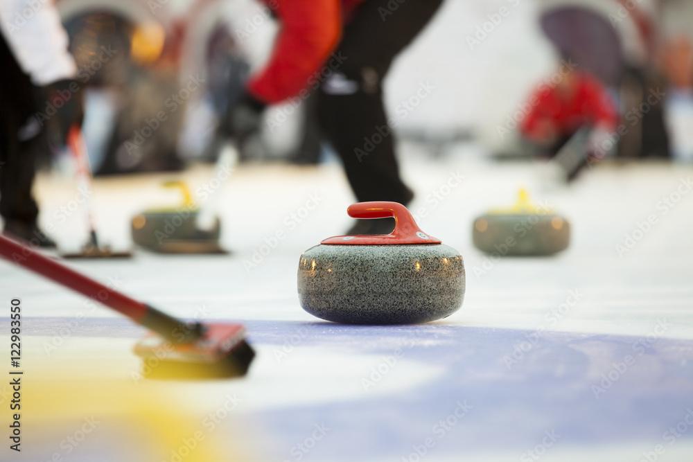 Fototapeta Curling stones on ice