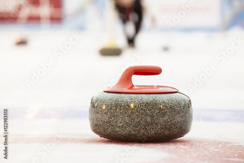 Curling stones on ice Fototapet