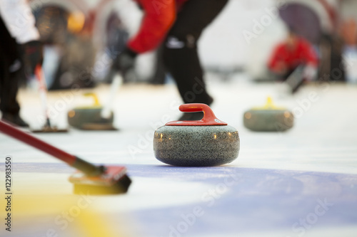 Curling stones on ice Poster Mural XXL
