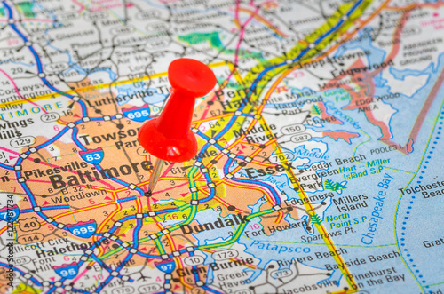 Pushpin Highlighting Baltimore, MD, on a Road Map - Buy this