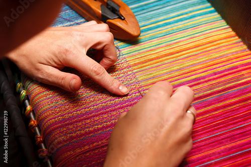 Woman's hands on the color warp Fototapeta