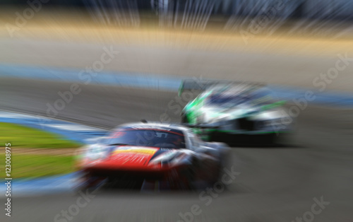 car racing on the road and track with motion blur and Radial blu