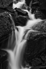 Obraz na PlexiBeautiful waterfall in forest landscape long exposure flowing th