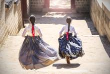 Two Korean Girls Dressed In Tr...
