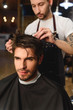 face of man visiting hairstylist
