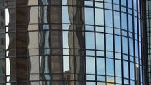 Reflective Building Window -Long Shot / Tilt Up-