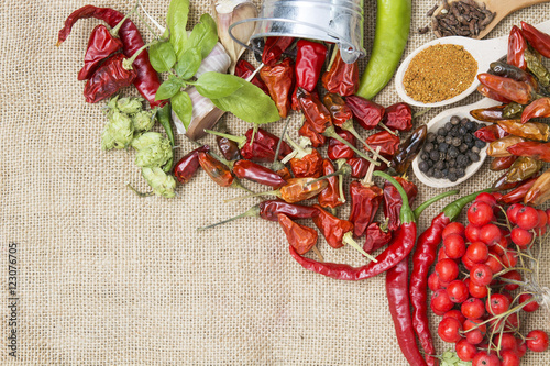 chili pepper, Various spices on old wooden, room for text. toned image frame