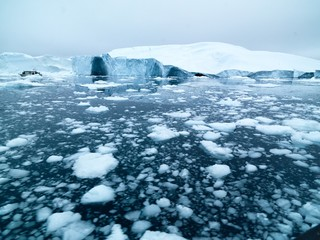 Beautiful icebergs are on arctic ocean in icefjord