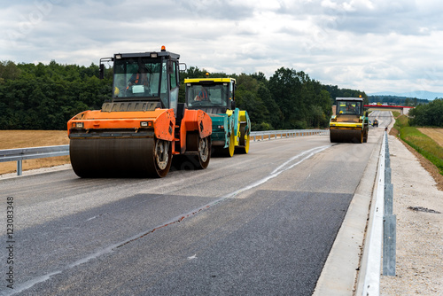 Fototapety, obrazy: Road roller working on the construction site