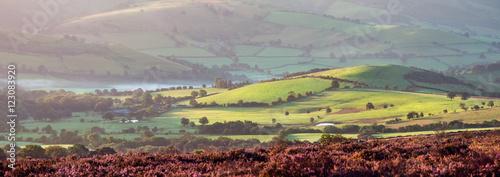 Foto auf Gartenposter Hugel Panoramic View of British Farmland in Sunrise Light