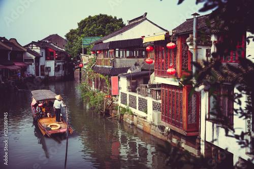 Tuinposter China China traditional tourist boats at Shanghai Zhujiajiao town with boat and historic buildings, Shanghai China
