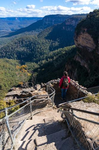 Obraz na plátne Woman looking on vast mountain landscape from observation deck
