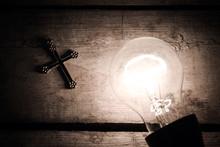 Cross And Bulb