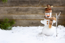Snowman With A Broom On A Wooden Gray Background , Child's Handiwork