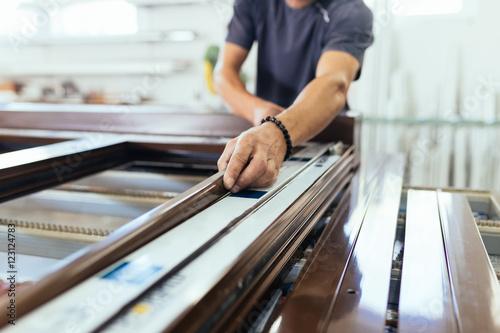 Manual worker assembling PVC doors and windows Canvas Print