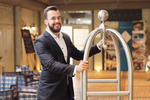 Vászonkép Bellboy in hotel