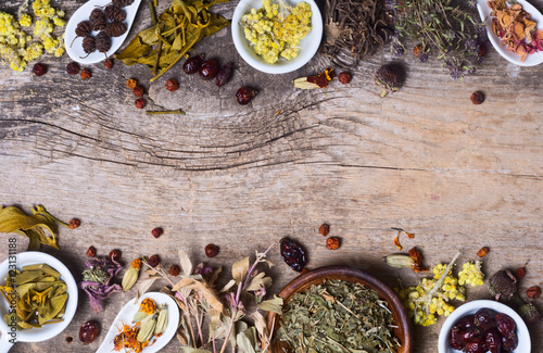 Herbs in wooden spoon Canvas Print