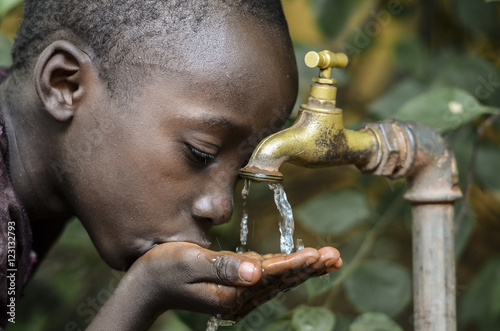 Little African Boy Drinking Healthy Clean Water from Tap