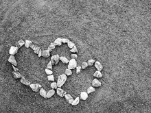 Bordered By Stone Heart Of Love On The Sand Gray.