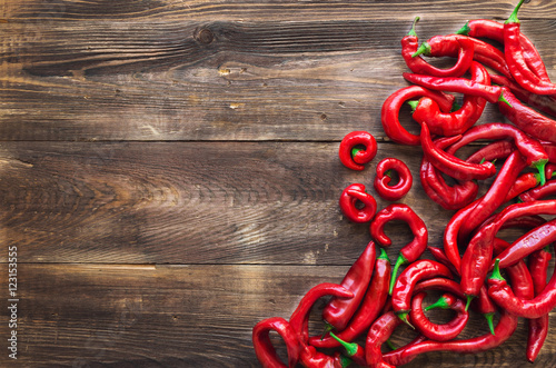 Tuinposter Hot chili peppers Organic fresh red hot chili peppers