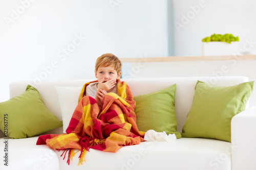Fotografia  sick kid with runny nose and fever heat at home