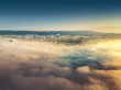 Flying above the clouds, view toward the city