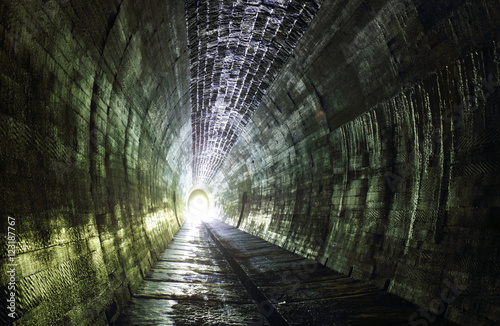 Papiers peints Tunnel Light at the and of tunnel.Ancient cemetery around