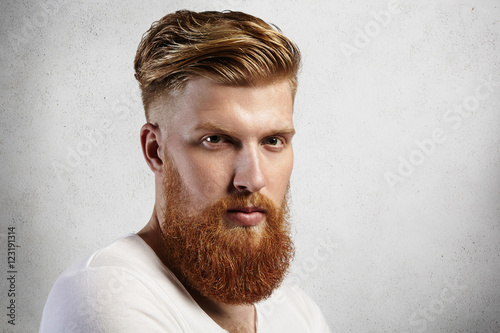 Fotografie, Obraz  Sideways portrait of natural blond Caucasian man on white background