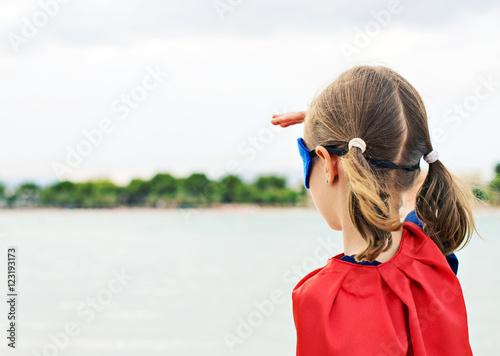 Superhero kid looking into distance. Poster