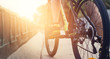 low angle view of cyclist bicycle on street at sunrise, soft focus