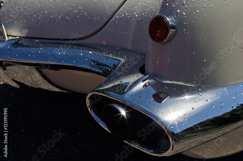 Photo  chrome exhaust pipe in a retro car