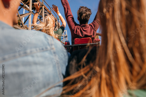 Poster Amusementspark Friends on roller coaster ride at amusement park
