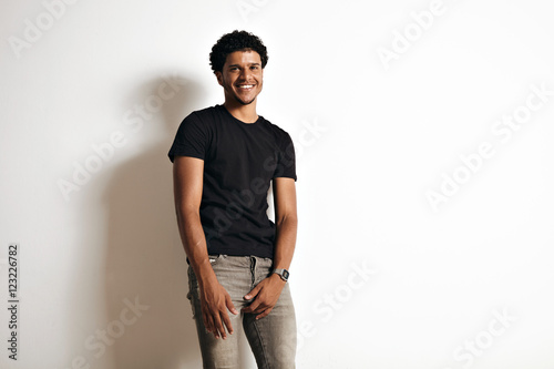 Fotografie, Obraz  Happy smiling inviting sexy young black male in tight grey jeans and blank cotto