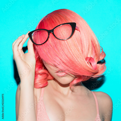 Photo  Sensual lady in elegant glasses. Retro style. Pink hair trend
